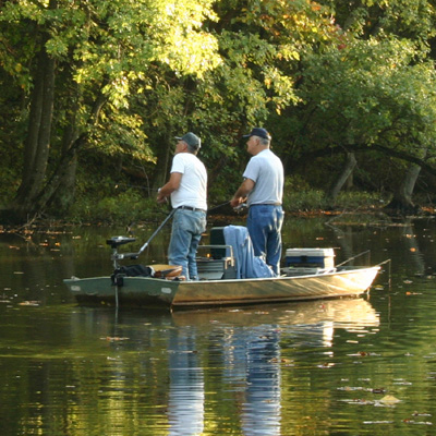 JON BOAT - Perfect for hunting, fishing, or trolling, this 15-foot Jon Boat includes a 15HP motor and trailer.