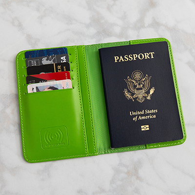"SMOOTH TRIP<sup>&reg;</sup> RFID-Blocking Passport Holder - Protect your credit card, license and passport information against electronic scanner theft with this RFID lined holder.  Space for 5 cards and 2 pockets for receipts and money.  Measures 3.75"" x 5.5""."